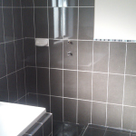 Black tiles with white groute