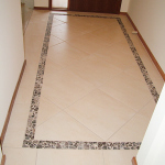 Tiled entrance floor - diamond lay inside stone border feature