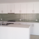 Glass mosaic tiled splashback