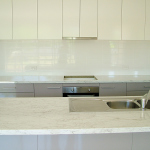 White tiled kitchen splashback