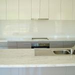 White tiled kitchen splashback