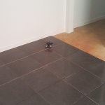 Laser guided floor tiling
